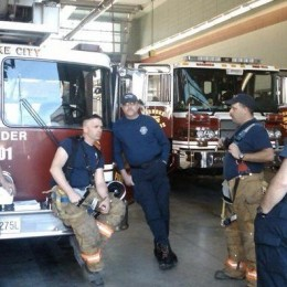 Station 1 guys hanging out after a call. He is seated on the front of reserve ladder 901. Photo from Station 1 Blog