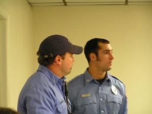 Retirement Dinner: On duty firefighters look on.