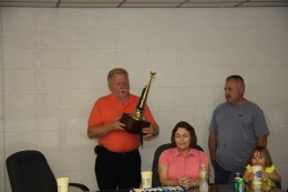 Chief Slayton accepting a bugle from Chris Trussler